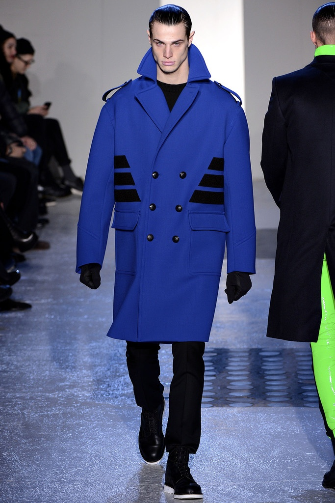 Blue Double Breasted Oversize rounded shoulder jacket with a military inspiration due to the shoulder straps. #Mugler #Menswear #FW2013