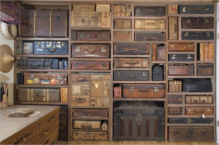 Suitcases & trunks forming beautiful, old world, custom storage & display,in her studio... Gail Rieke