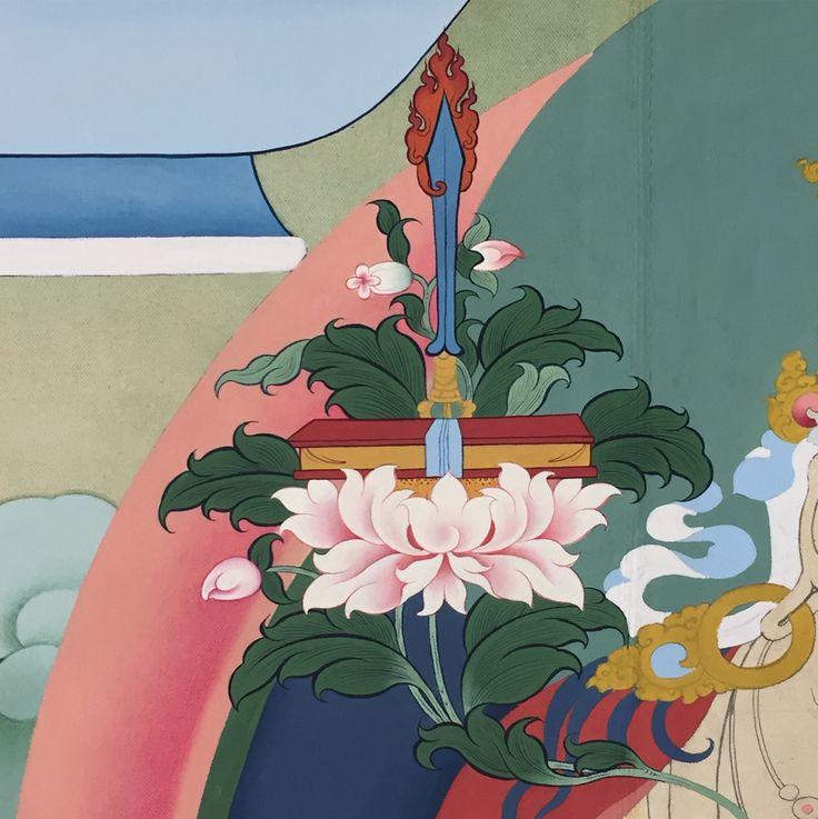 Thanbhochi detail: Manjushri's sword and dharma text.