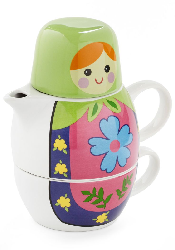 When stacked, the ceramic cup, petite teapot, and lid resemble a little Matryoshka doll, who is dressed in a cheerful floral apron and a sweet green scarf. Simply prepare the water, steep the leaves,