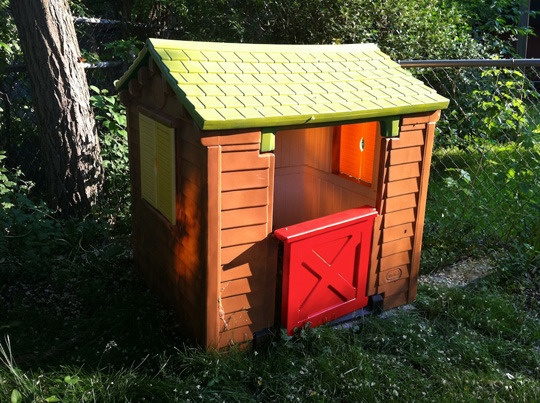 Repaint a Little Tykes playhouse into a log cabin.  Why didn't I think of that?