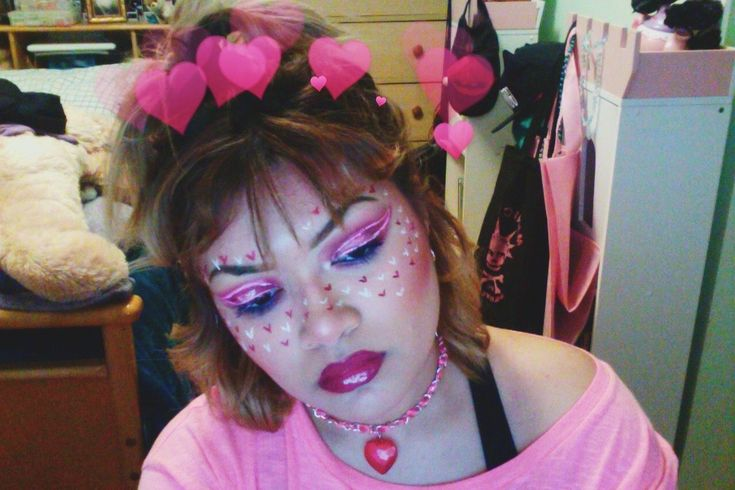 Valentine's Day inspired makeup I did today. A lot of pinks. I used morphe, bh cosmetics, Anastasia Beverly Hills Modern Renaissance Palette, Dipbrow in Ebony, The hearts were made with NYX White liquid eyeliner & Milani liquid lipstick in Devotion. Lipstick I'm wearing is by Elf called Berry Sobret with Estée Lauder lip gloss on top :)( #nails, #style, #womensfashion, #makeup, #makeupartist, #tumblr, #aesthetic, #pink, #ValentinesDay, #Hair, #hairstyles #pinklipsaesthetic #elfmakeup