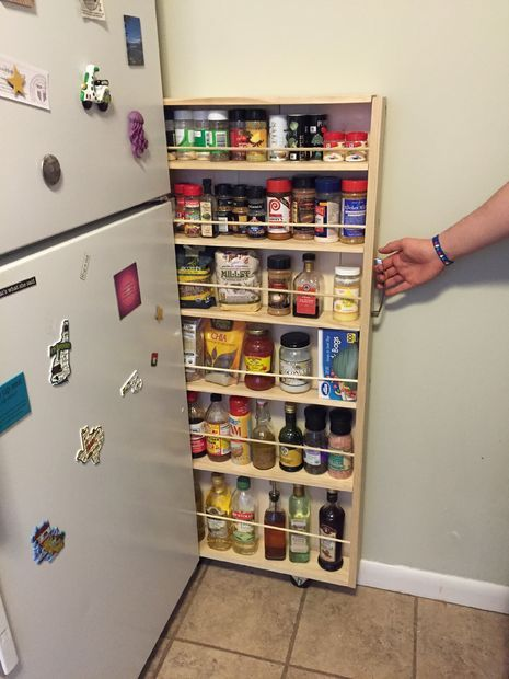 Hidden Fridge Gap Slide-Out Pantry .  I would make this taller.  If you're worried about heat, you could make it into a lid rack!