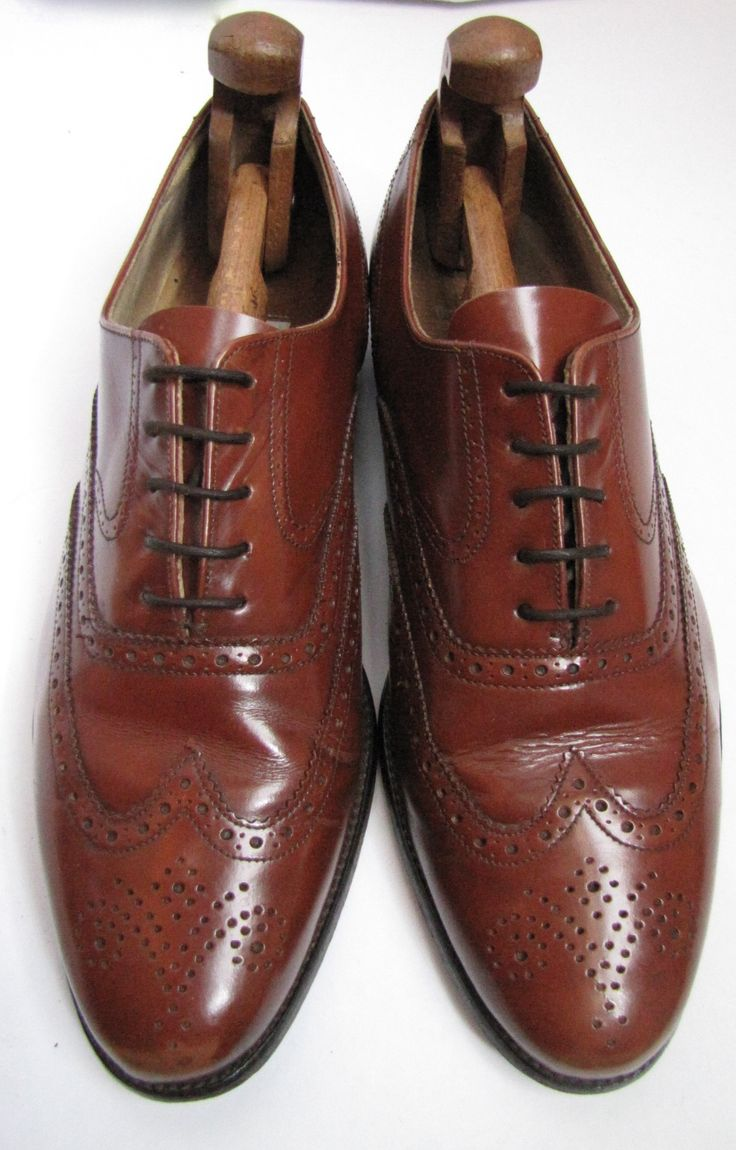 Classic oxford shoe with wingtip brogue pattern in light chestnut tan calf  leather. Made in