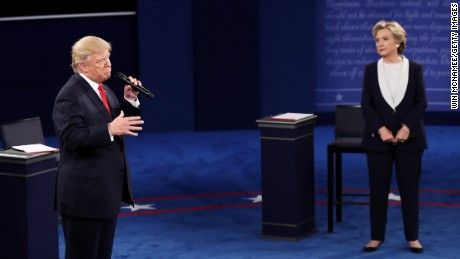 Clinton, Trump clash in 2nd debate: CNN's Reality Check team vets the claims ST LOUIS, MO - OCTOBER 09:  Republican presidential nominee Donald Trump (L) speaks as Democratic presidential nominee former Secretary of State Hillary Clinton looks on during the town hall debate at Washington University on October 9, 2016 in St Louis, Missouri. This is the second of three presidential debates scheduled prior to the November 8th election.  (Photo by Win McNamee/Getty Images)