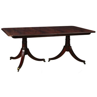 The Haverford Dining Table, from Stickley Furniture's Classic Collection featuring radius corners with inlaid border, two three-legged pedestal bases with brass toes and casters, all made of solid mahogany.