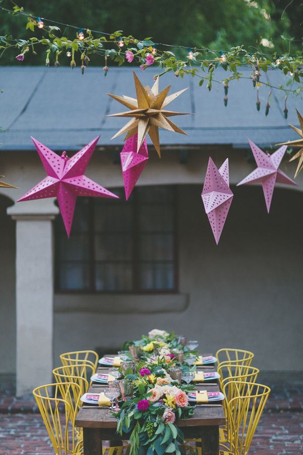 hanging metal star lanterns, photo by Two Foxes Photography, styling by E Events Co http://ruffledblog.com/tropical-july-4th-styled-wedding #weddingideas #weddingreception #hangingdecor