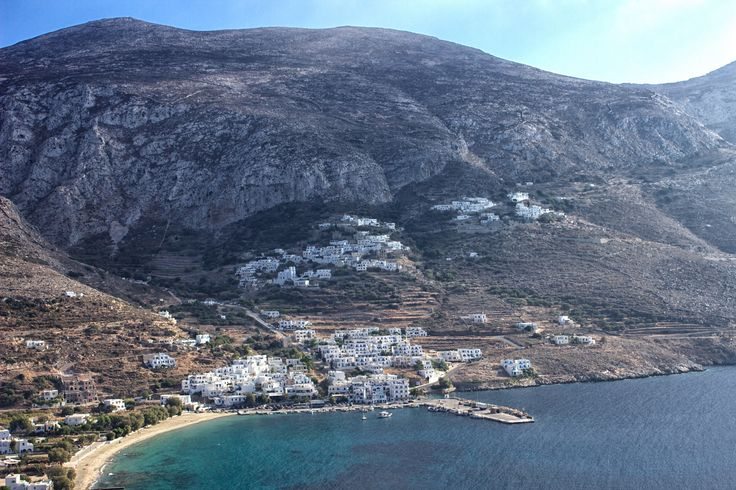 View of Aegiali down by the sea and Potamos up in the hillside, Amorgos.