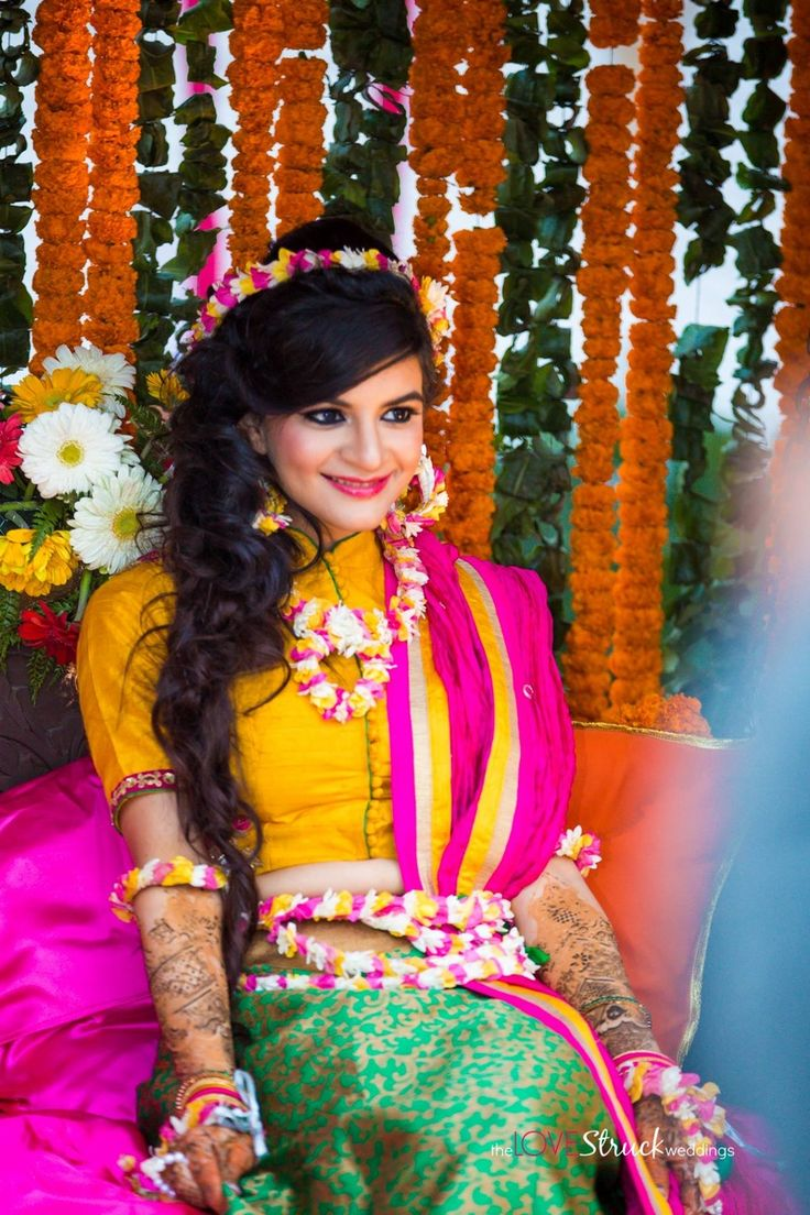 Love how this bride paired her vibrant mehendi outfit with pop-tactic floral jewellery.