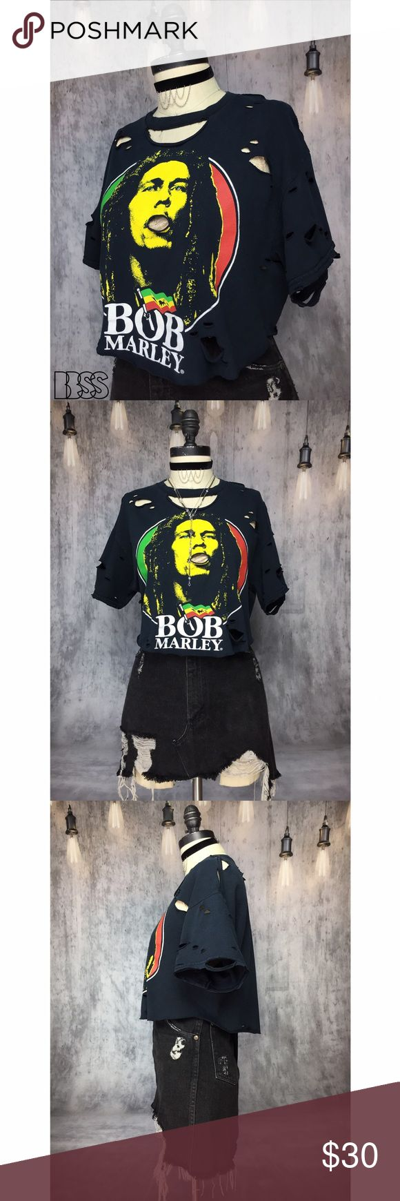 BOB MARLEY DISTRESSED SCALLOPED GEM CROP TSHIRT!! BOB MARLEY DISTRESSED SCALLOPED GEM CROP TSHIRT!! Super cute classic BOB MARLEY iconic music legend TEE!! Shirt has been cropped, scalloped, distressed with rhinestone details! Fabric is COTTON worn in faded vintage black! PERFECT for SUMMER FESTIVALS AND CONCERTS! MEASUREMENTS - BUST: 19.5' / LENGTH: 17' (longest) 14.5' (sides) Marked size MEDIUM #grunge #band Vintage Tops Crop Tops