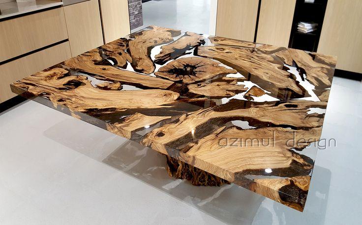 tavolo in resina e legno d'olivo realizzato tenendo come base una parte del tronco e componendo il top con i pezzi rimanenti #azimutresine #azimutdesign