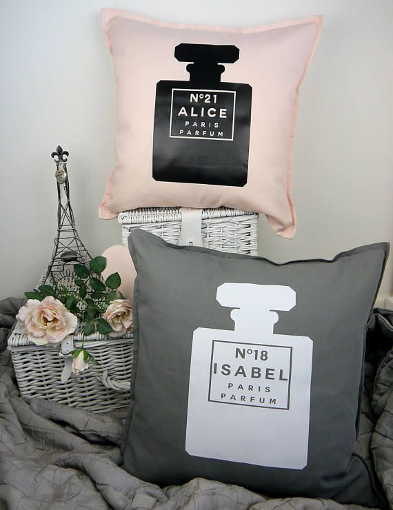 Oh la la! Add a touch of glamour to any room with this fabulous large throw pillow! This gorgeous cushion has a large classic style perfume bottle graphic which is personalised to your choice, and comes in either beautiful baby pink with a black graphic or chic dark grey with a white