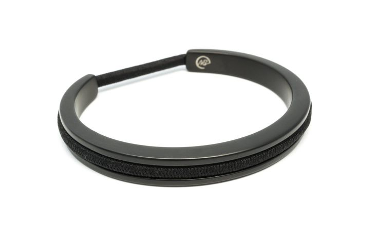 "- Hair tie bracelet in lightweight aluminum with black matte plated finish - one size, best fits wrists up to 6-6.75"" in circumference - can accommodate both skinny and thick hair tie elastics This st"