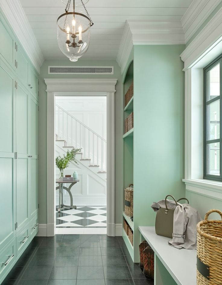Gorgeous mint green mudroom by Denise Maloney with built-in storage and a bell-jar pendant light - fabulous mouldings too.