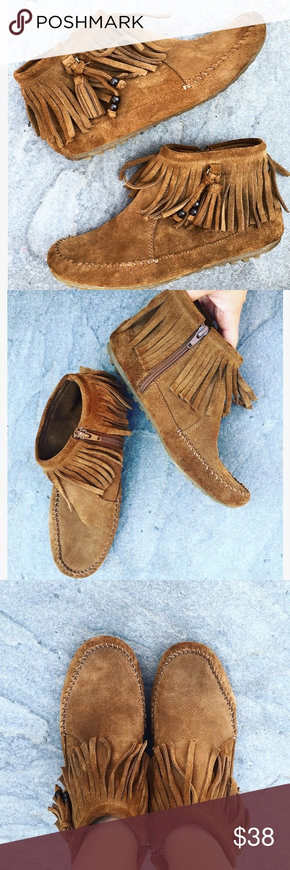 Minnetonka fringe bootie moccasins Ankle high, super soft, so incredibly comfy. Worn as slippers or out. Minnetonka Shoes Moccasins