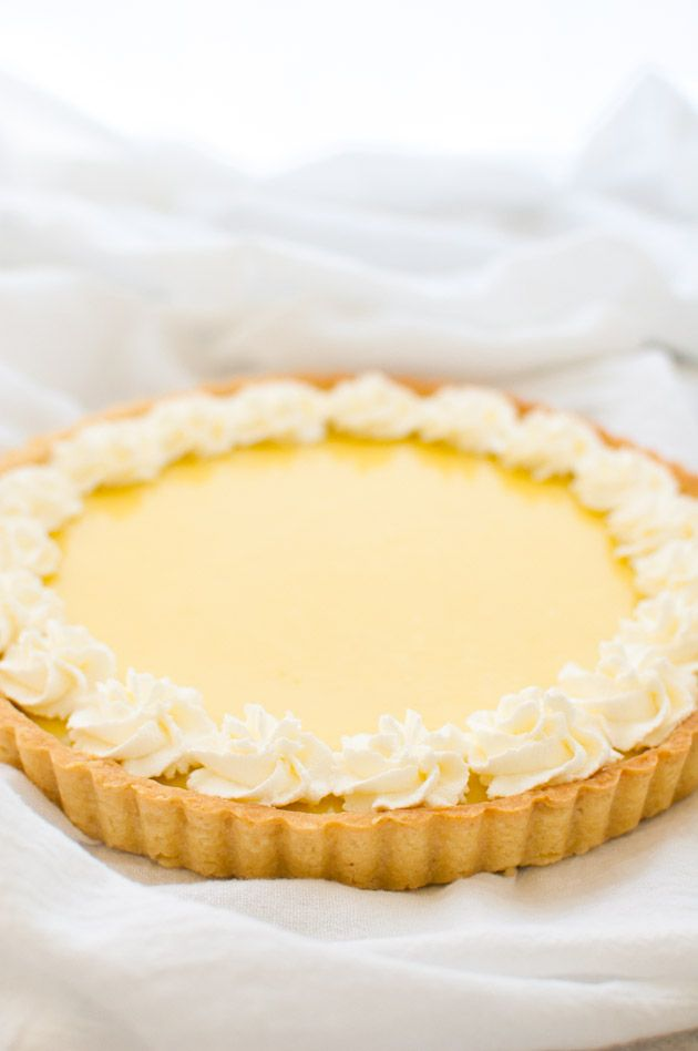 Classic lemon tart with a lemon curd filling in a buttery tart shell from tamingofthespoon.com