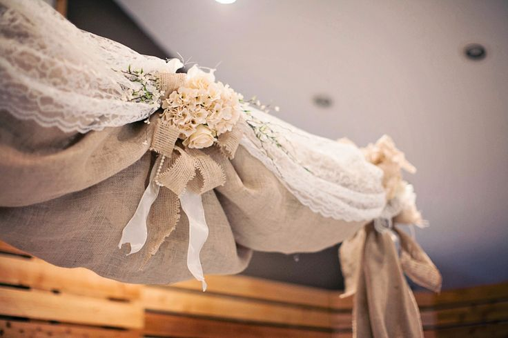 beautiful draping burlap and lace are pieced together for a rustic alter  I thereddirtbride.com I see more of this wedding here