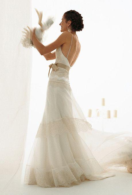 Brides: Le Spose Di Gi�. Spaghetti straps, deep V-neckline, low waisted lace, and organza dress.