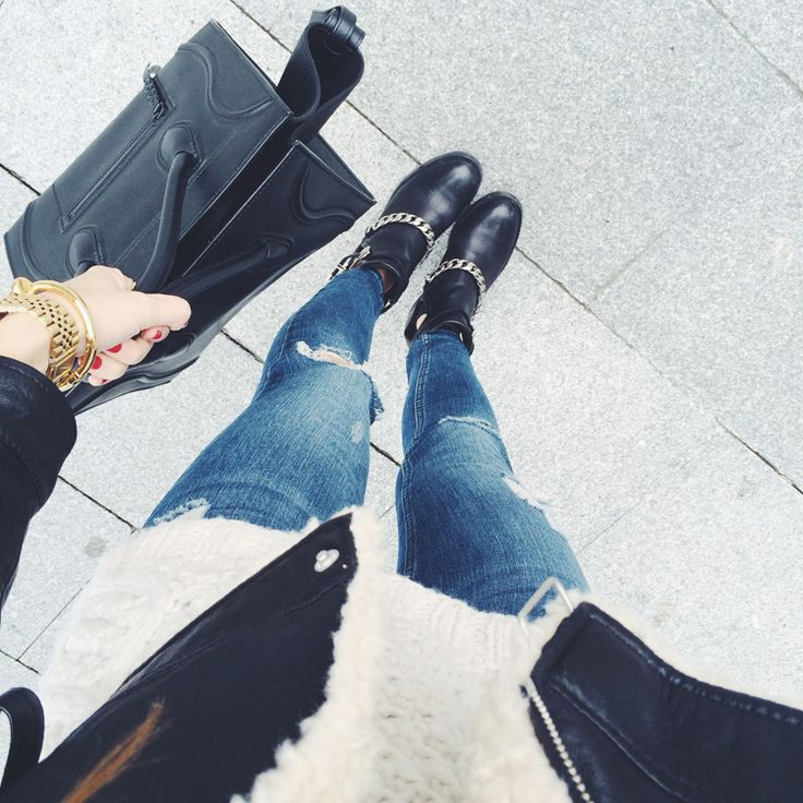 Sandro boots & ripped jeans.