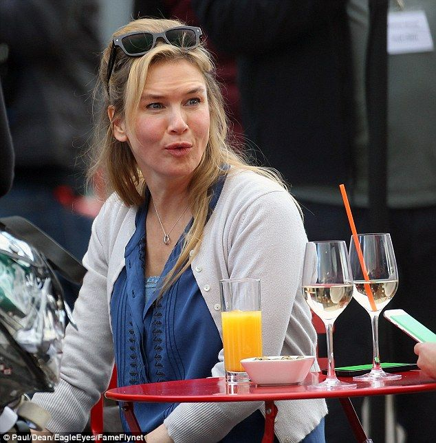 No bump! Renee Zellweger was definitely not 'mit bebe' when she shot scenes alongside co-stars James Callis and Sally Phillips in London on Friday afternoon
