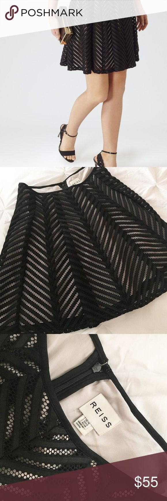 Reiss Anra Skirt Reiss Anra skirt size US6. This is black with a pale nude slip underneath and is perfect for this time of year and can be worn all throughout the spring! Reiss Skirts Midi