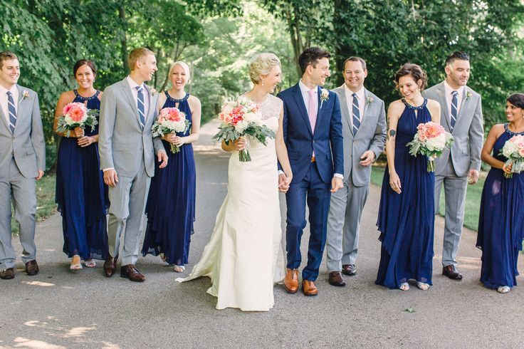 Each of the five groomsmen wore light gray Ludlow suits and navy ties from J. Crew along with light pink shirts from Nordstrom.