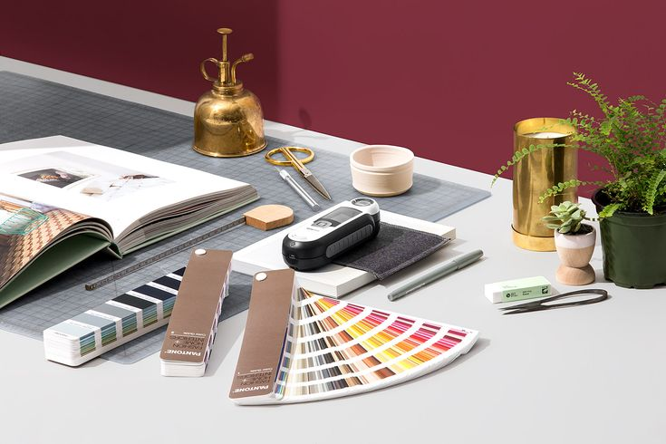 """The Capsure and Fashion, Home + Interiors guide set includes the paper color guides of all 2,310 FHI colors, along with the Capsure device which houses all Pantone libraries of over 10,000 colors. Use the portable Capsure device to """"capture"""" color from any surface, allowing you to collect inspiration and match it to any Pantone color with a simple click of a button. The FHI Guide serves as a quick physical reference tool when selecting and communicating your Pantone color."""