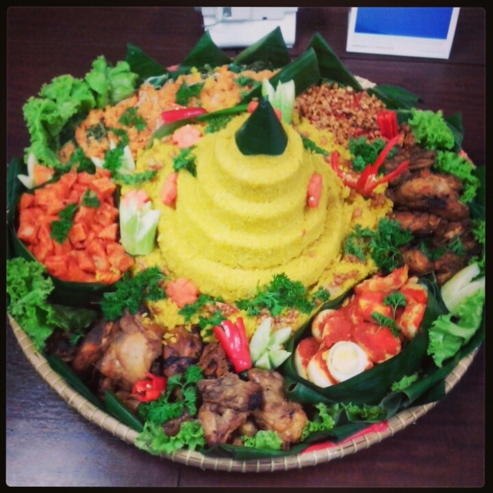 NASI TUMPENG.  (yellow rice with many dishes. Indonesian food for celebrate event).