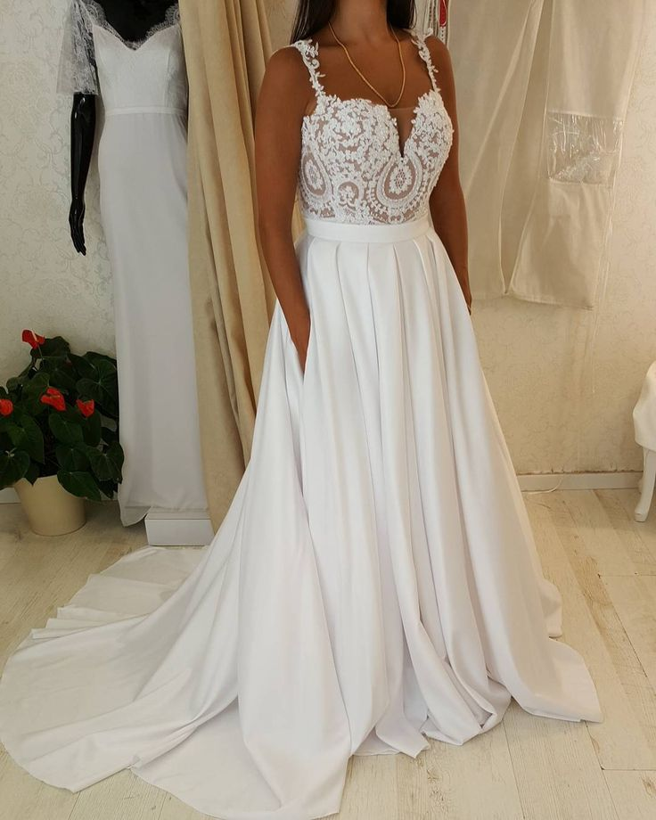This plus size bridal gown has pretty straps going over the shoulders. The lace detail on the bodice is amazing.  You can have #plussizeweddingdresses lke this custom created for your shape & size with any changes. We are in the USA and specialize in affordable custom wedding gowns as well as #replica of haute couture gowns that cost much less than the original.  Contact us for pricing on any dress.