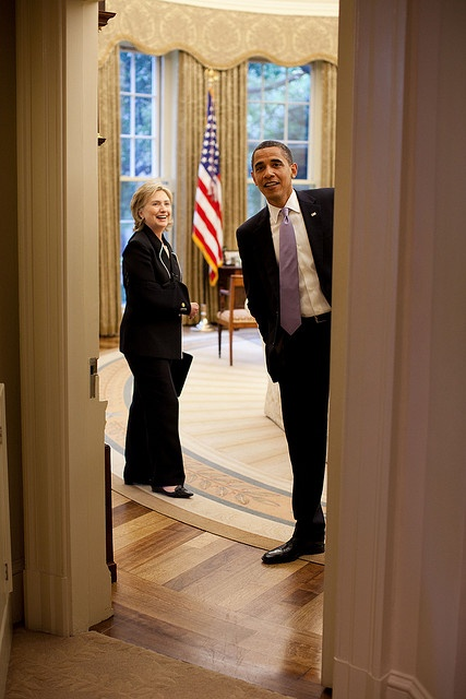 President Barack Obama looks out of the Oval Office for other aides before a meeting with Secretary of State Hillary Clinton on July 1, 2009.