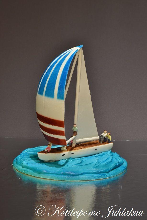 Fondant sailboat decoration