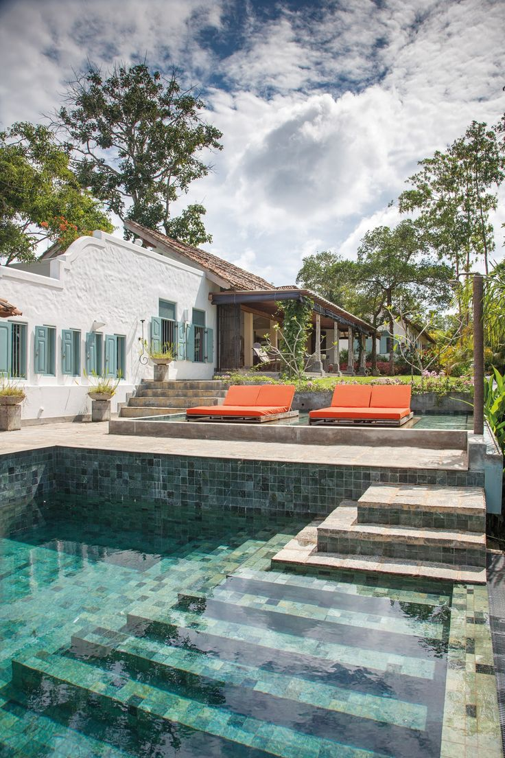 The interior of Sri Lankan a swimming pool is clad with small stone mosaic tiles | archdigest.com