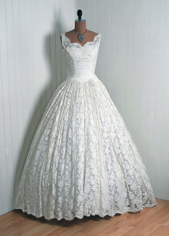 Couture Wedding Dress, Cahill-Beverly Hills: 1950's, fully-lined Chantilly lace, scalloped sweetheart bodice, full-length full circle skirt.