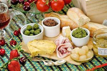 Antipasto with summer herb pesto and tapenade