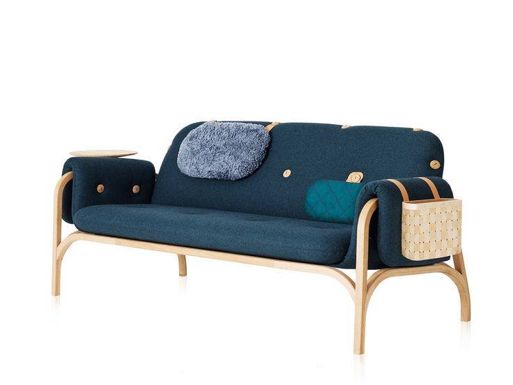 The Swedese Button Sofa by Front is a beautifully crafted oak-framed sofa, featuring wooden buttons that allow the user to customise their sofa experience, with the addition of a set of highly useful accessories.