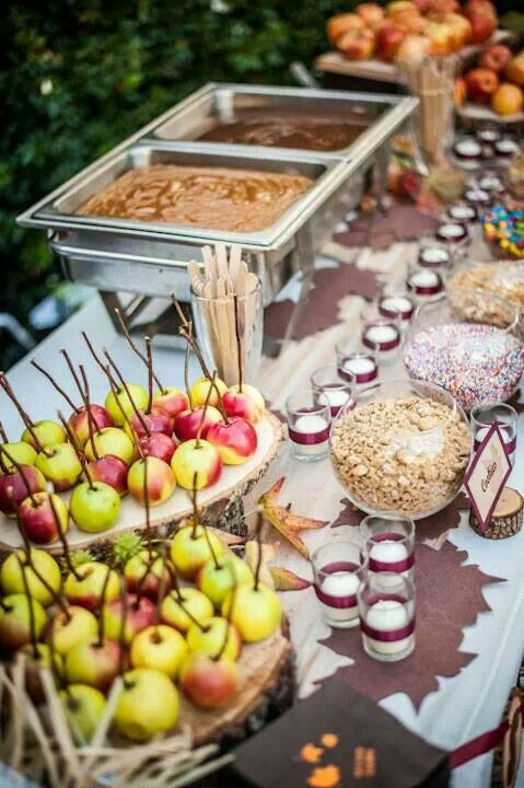 Caramel apple bar for Halloween party ... Thinking about bringing something like this. Apple slices instead of whole apples.