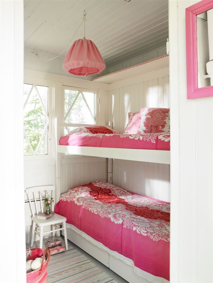 Bunk beds are ideal for sleeping in the pink (bedding that is). Easy DIYs in this Swedish summer cottage bedroom.
