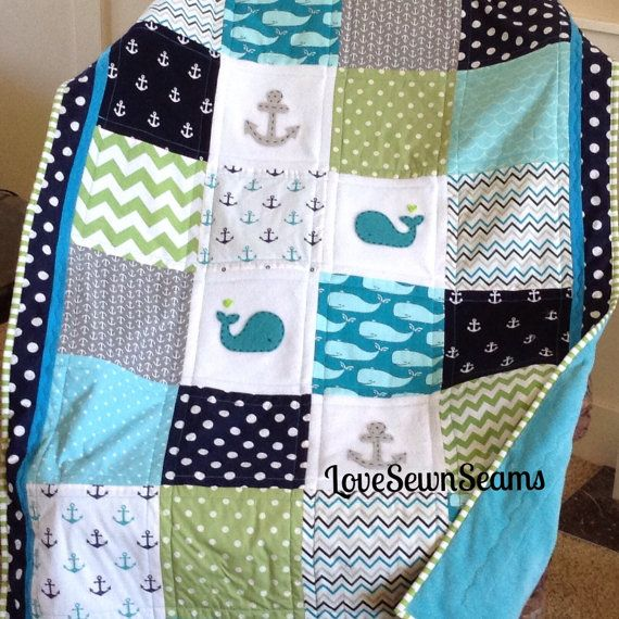 This Baby Whales quilt is Lovesewnseams signature style quilt. Designed from love of whales, the ocean and the beach. 100% Cotton quilting fabrics in Teal, navy and green coordinate beautifully with the hand stitched and appliquéd baby whales and anchors. Backed in soft ultra cuddly