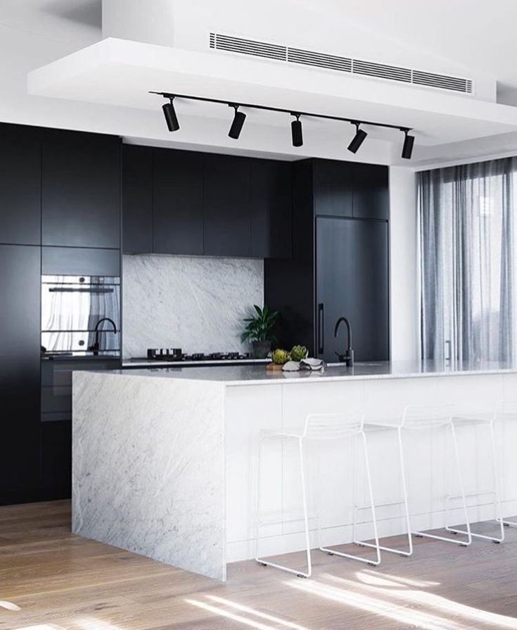 white modern kitchen marble. sophisticated high end kitchen colour palette perfection black white and marble blonde floors modern