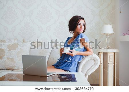 Fashion morning portrait of beautiful shy brunette sexy woman wearing luxury glamour lingerie,posing alone at her bedroom, boudoir style.waiting for husband,alone, macbook style