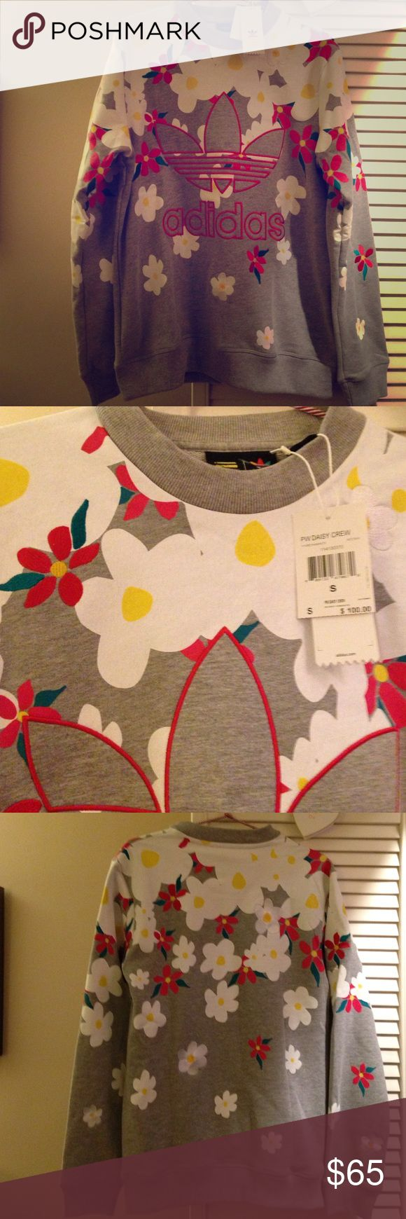 🌼Pink Beach by Pharrell Williams and Adidas Crew Heathered grey with multi-colour daisy print and embroidered detail Cotton-blend sweatshirt jersey Apple red trefoil logo embroidery at centre front Ribbed crew neck, cuff and hem 92% Cotton, 8% Polyester Adidas Shirts Sweatshirts & Hoodies