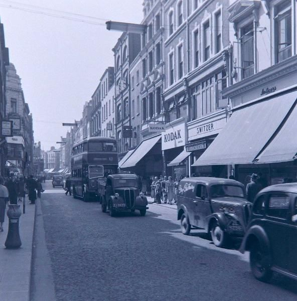 Grafton Street with green buses