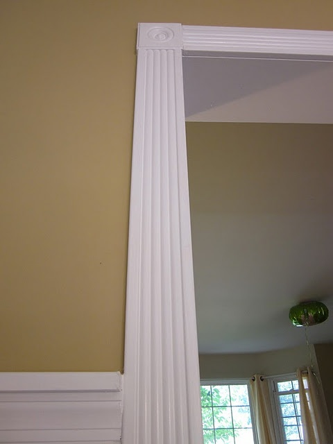 Fluted moulding and rosette around door facing or windows for Window 5 nmat