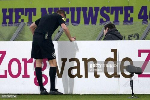 01-29 Referee Pol van Boekel checks a tv monitor to cancel a... #boekel: 01-29 Referee Pol van Boekel checks a tv monitor to… #boekel