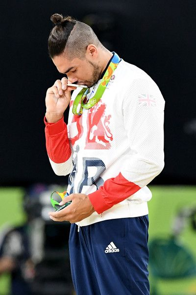 Silver medalist Louis Smith of Great Britain kisses his medal on the podium at the medal ceremony for the Men's Pommel Horse Final on Day 9 of the Rio 2016 Olympic Games at the Rio Olympic Arena on August 14, 2016 in Rio de Janeiro, Brazil.