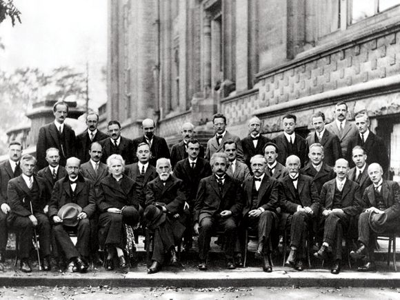 The 1927 Solvay conference on particle physics: back row, third from right, Werner Heisenberg, sixth from right, Erwin Schrödinger; middle row, from right, Niels Bohr, Max Born, Louis de Broglie and centre, Paul Dirac. Front row, second from left, Max Planck, next to him, Marie Curie, then Hendrik Lorentz and Albert Einstein. Of the 29 pictured, 18 won Nobel prizes, Curie in both physics and chemistry.