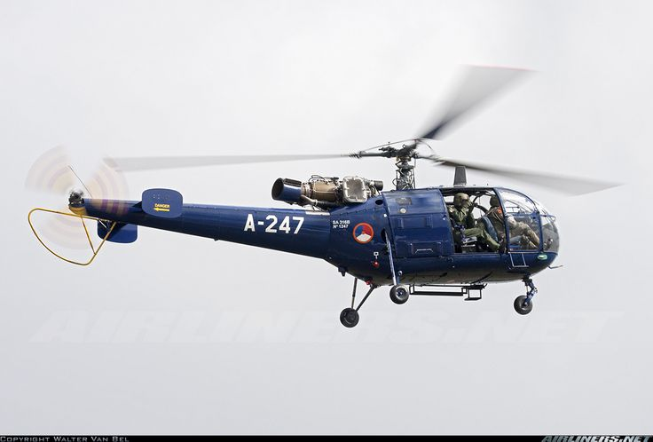 """The crew of this Royal Netherlands Air Force SA-316B Alouette III (A-247, cn1247) was taking pictures of the spotters and spectators during the """"Luchtmachtdagen 2013"""" at Volkel Air Base."""