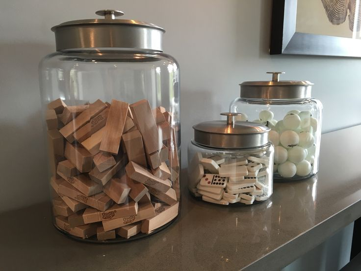 Love this idea for a kids room or game room! Dominos, jenga, and ping pong balls in cute see through containers. Decor and useful storage!