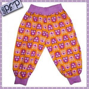 LilliPOP barnkäder: LilliPOP byxor i orange med lila ugglor.