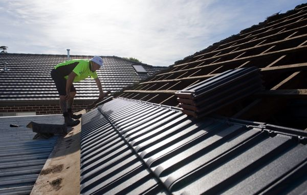 Re-Roofing: Secure the new tiles to battens.